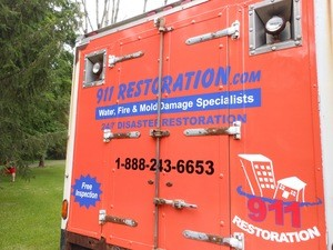 Water Damage Restoration Box Truck Rear At Residential Job Location