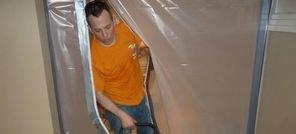 Water Damage Uxbridge Technician Using Air Mover Near Vapor Barrier