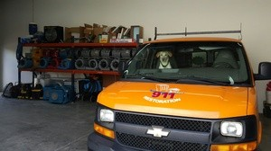 Water Damage Restoration SUV and Dog At Warehouse