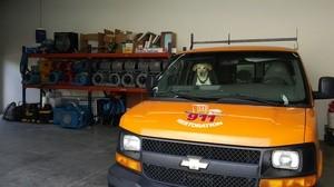 Water Damage Restoration SUV and Dog At Warehouse