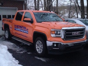 Water Damage Restoration Truck At Winter Flooding Site