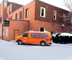 Water Damage Restoration Van At Snowy Civic Job Site